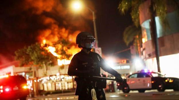 George Floyd death: Widespread unrest as curfews defied across US